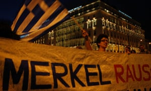 Anti-austerity protest outside the Greek parliament, a day before the visit by German Chancellor Angela Merkel.