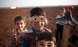 Syrian refugee children play in a camp at the Syrian-Turkish border near Azaz. The makeshift refugee camp is reported to be growing daily, housing several thousands of refugees now under poor sanitary conditions and controlled by the Free Syrian Army.