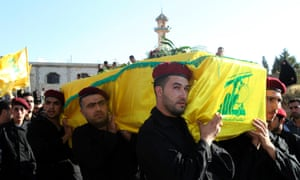 Lebanon's Hezbollah members carry the coffin of a Hezbollah member during his funeral in Ansar village near  Baalbek city October 8, 2012. Hezbollah gave no details about their deaths but sources in Baalbek said they and another Hezbollah man were killed near a Syrian border town where rebels are fighting Assad's forces.