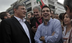 Greek main opposition SYRIZA party leader Alexis Tsipras (R) accompanied by German leader of Die Linke party Bernd Riexinger,stand in front of the parliament during  a demonstration against the visit of the German Chancellor Angela Merkel on October 9, 2012.