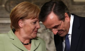 Germany's Chancellor Angela Merkel (L) speaks with Greece's Prime Minister Antonis Samaras following a joint statement on October 9, 2012 at the Maximos mansion in Athens.