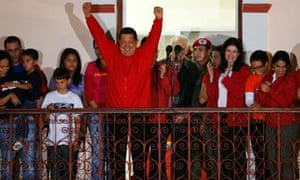 Venezuelan president Hugo Chavez celebrates from people's balcony at Miraflores Palace in Caracas