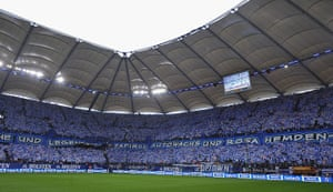 Tifo: Fans of Hamburg hold banners celebrating 125 years of their club