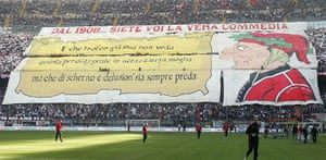 Tifo: AC Milan's fans hold a banner against Inter Milan's fans