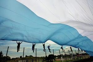 Tifo: Argentine fans wave a giant Argentine flag