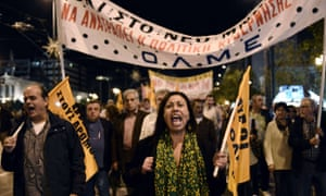 A woman shouts slogans during a demonstr