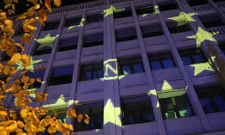 The stars of the European Union flag are projected on  to a building in Berlin.