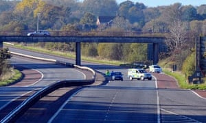 Police at the scene of the murder of a Prison Officer on M1 Motorway, Lurgan, Northern Ireland