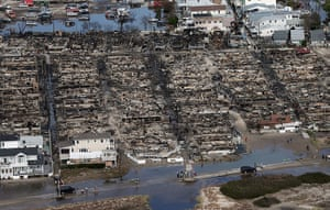 From the agencies: People gather around the remains of burned homes after Superstorm Sandy