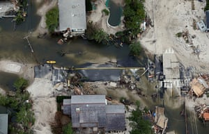 From the agencies: The remains of a road are mired in debris and water from Superstorm Sandy