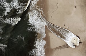From the agencies: Flood water from Superstorm Sandy is pumped into the ocean from the beach