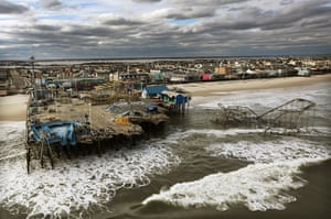 From the agencies: Waves break in front of a destroyed amusement park