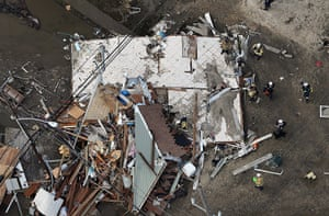 From the agencies: Rescue workers gather around a house wrecked in Seaside Heights, New Jersey