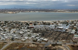 From the agencies: The remains of burned homes are surrounded by water, Queens