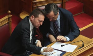 Antonis Samaras (on the right) talking to Yannis Stournaras in parliament yesterday.