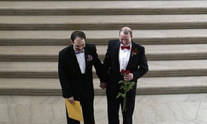 A newlywed gay couple walks down the stairs of  San Francisco City Hall 20 February 2004