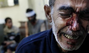 Grieving father in Aleppo