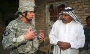 The then US commander in Iraq, General David Petraeus, left, talks with Assal Jassim