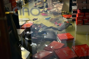 Venice floods: Shoes and wellies float in a flooded shop