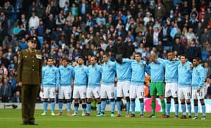 UK Remembrance Day: Manchester City players acknowledge a minutes silence