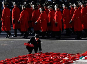 UK Remembrance Day: A man lays a wreath as the Chelsea Pensioners parade past