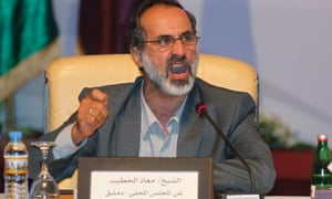 Mouaz al-Khatib was elected as the first leader of a new Syrian opposition umbrella group that hopes to win international recognition and prepare for a post-Assad Syria.