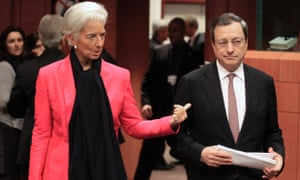 International Monetary Fund (IMF) Managing Director Christine Lagarde (L) talks with European Central Bank (ECB) President Mario Draghi at a Eurogroup meeting in Brussels November 12, 2012.