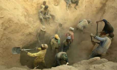 Miners dig for diamonds in the Marange fields, Zimbabwe