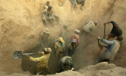 Miners dig for diamonds in the Marange fields, Zimbabwe