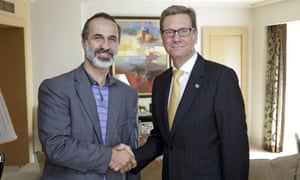 German foreign minister Guido Westerwelle (right) meets Moaz al-Khatib, leader of the new Syrian opposition coalition in Cairo
