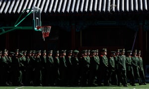 Carlos Barria China: Paramilitary policemen march inside of the Forbidden City