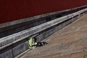 Carlos Barria China: A man sleeps inside the Forbidden City