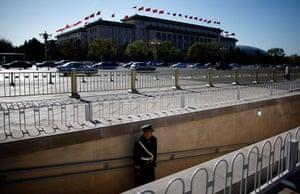 Carlos Barria China: A paramilitary policeman guards an underpass