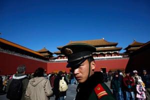 Carlos Barria China: A paramilitary policeman guards an area inside the Forbidden City