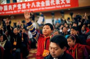 Carlos Barria China: Zhang Jiahe, from the Chinese Teenagers News, raises his hand