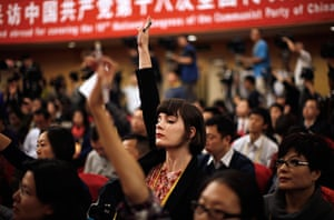 Carlos Barria China: A foreign journalist raises her hand to ask a question during conference