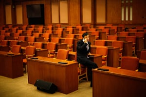 Carlos Barria China: A man talks on the phone at The Great Hall of the People