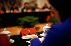 Carlos Barria China: A delegate attends a meeting at the Great Hall of the People