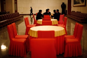 Carlos Barria China: Staff members sit around a table as they take a break