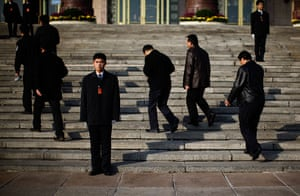Carlos Barria China: Security guards keep watch as delegates walk the Great Hall of the People
