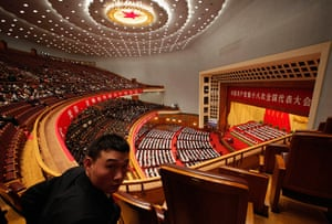 Carlos Barria China: A security officer looks back as China's President Hu Jintao speech