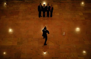 Carlos Barria China: Staff pose for pictures inside the Great Hall of the People