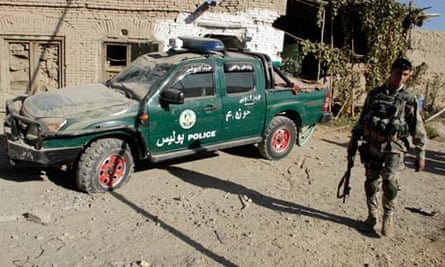 The site of a suicide blast in Kandahar, which killed three Afghan police officers