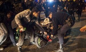 Policeman clash with a demonstrator who tried to prevent the departure of buses on the parking lot of the Madrid Bus Company during a general strike on November 14, 2012 in Madrid.