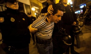A picketer is arrested by riot police officers after trying to close a pub with others picketers at the start of a nationwide general strike in Malaga, southern Spain early November 14, 2012.