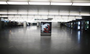 An advertising board is seen at a nearly empty arrival hall at Atocha rail station during a 24-hour nationwide general strike in Madrid, November 14, 2012.