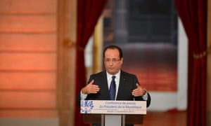 French President Francois Hollande gives a press conference to defend his record after six months in office at the Elysee Palace in Paris.
