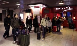 Passengers wait at the Thalys high-speed train terminal at Brussels Midi/Zuid rail station during an European strike November 14, 2012