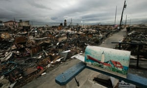 A mailbox with a lighthouse design sits on the porch of a burned out home in the Breezy Point section of New York's Queens borough. More than 50 homes were lost in a fire that swept through the oceanside community during Superstorm Sandy.