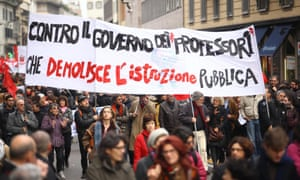 Italian CGIL trade union members and supporters hold banners as they march towards a demonstration against the austerity policy, in Milan, 14 November 2012.